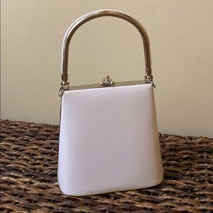 White purse with handle and straps